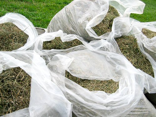 Bags of grass-and-alfalfa mulch
