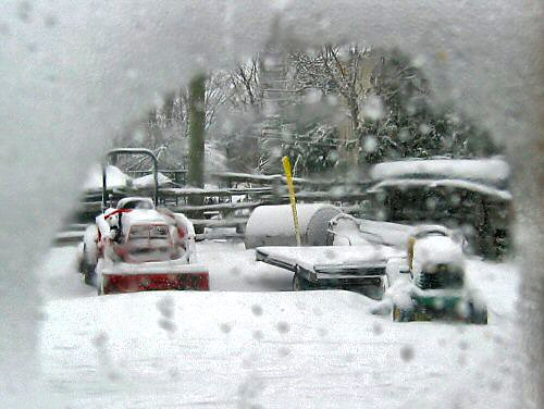 Tiny tractors slightly snowed in