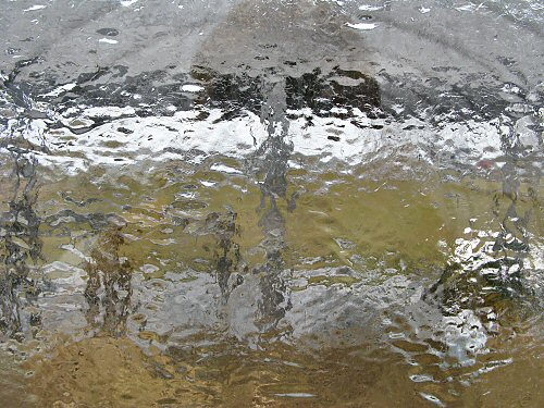 Freezing rain on glass