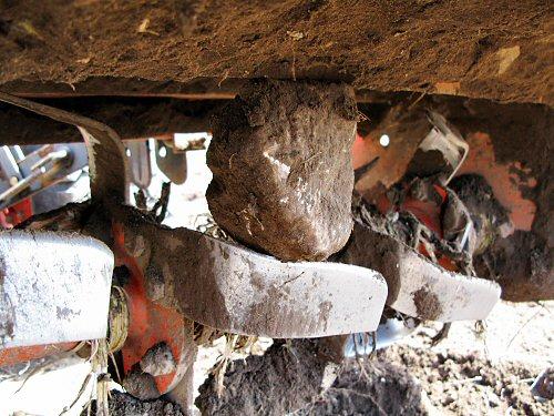 Rock stuck in tiller
