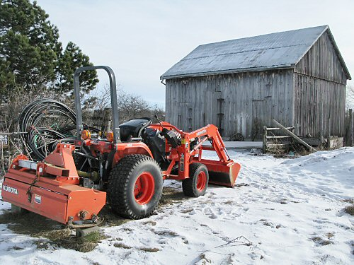 Compact Kubota and the barn