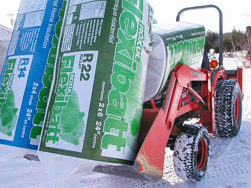 Kubota compact tractor loaded with insulation