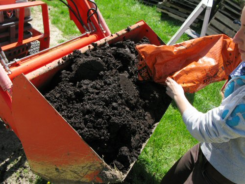 Loading the bucket with compost