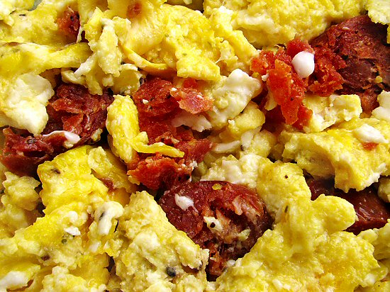 Farm eggs with hot sausage