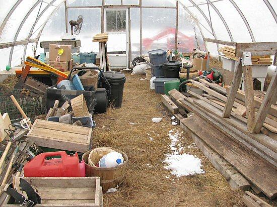 Farm gear stored in hoophouse