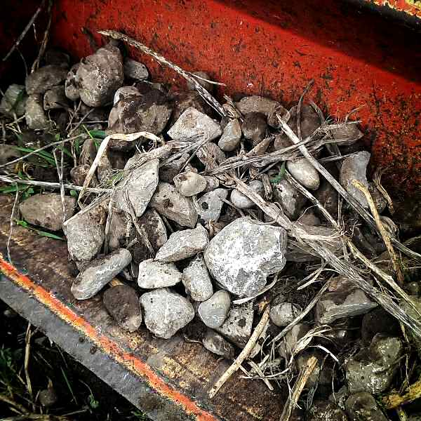 Rocks in front end loader bucket